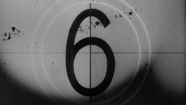 Number countdown on film leader with frames moving rapidly across screen and tearing