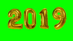 Number happy new year birthday anniversary celebration gold balloon floating on green screen background