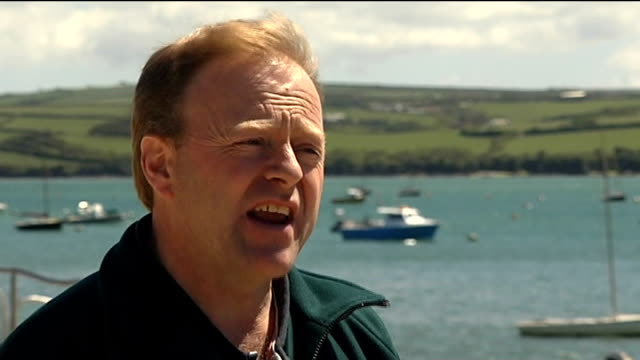 number of blue flag beaches in uk drops england cornwall rock ext bruce newport interview sot - bruce stock videos & royalty-free footage