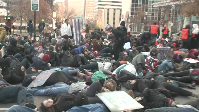 a number of clergy members and laypersons gathered for a mass die in outside of the buzz westfall justice center in clayton missouri on nov 25 2014 - clergy stock videos & royalty-free footage