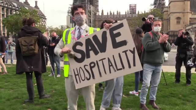 number of employees working at bars and restaurants in london have gathered at parliament square in protest against the latest covid-19 restrictions.... - corner stock videos & royalty-free footage