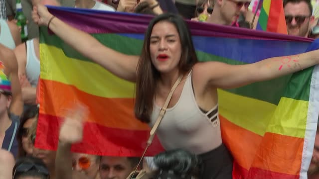 Number of homophobic hate crimes in London has doubled R080717007 / EXT High angle view crowd gathered for London Pride with rainbow flags Woman on...