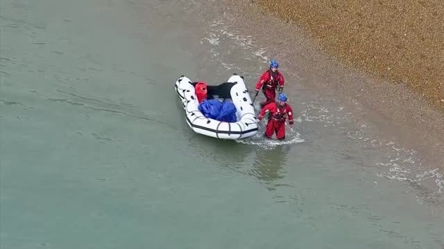 number of migrants crossing english channel to reach uk 'deeply concerning' says immigration minister england kent dover views / aerials rescue... - イングランド ケント点の映像素材/bロール