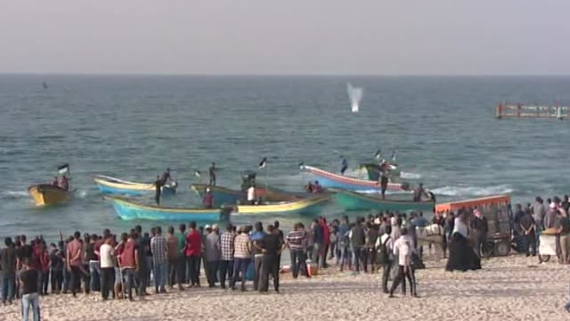 number of palestinian boats set sail in the northern gaza strip on october 22, 2018 as part of protests aimed to pile pressure on israel to end a... - 2018 gaza border protests stock videos & royalty-free footage