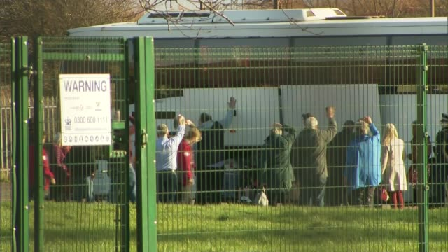 number of reported cases rise after change in the reporting method england the wirral ext coach carrying people evacuated from wuhan in china because... - picking up stock videos & royalty-free footage