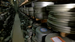 Numerous film reels being stored in film archive.