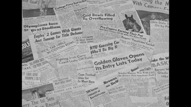 numerous newspapers spread on a floor, displaying sports headlines; magazines being dropped: sport life, basketball, the ring , turf, the rudder,... - 1940 1949 stock-videos und b-roll-filmmaterial