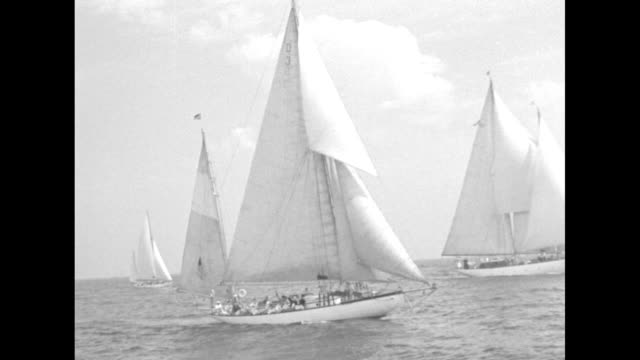 vs numerous sailing craft maneuvering in lake michigan and aerial views of the chicago world's fair - chicago world's fair stock videos & royalty-free footage