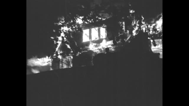 numerous shots of a wooden structure afire at night with a wall collapse; this might be the mansion built by boston rubber manufacturer arthur... - boston massachusetts stock videos & royalty-free footage