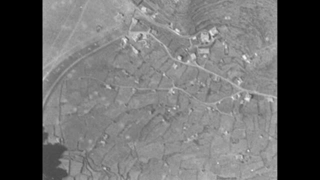 VS numerous shots of bombs dropping from B17 to fields far below and resulting explosions / Note exact day not known