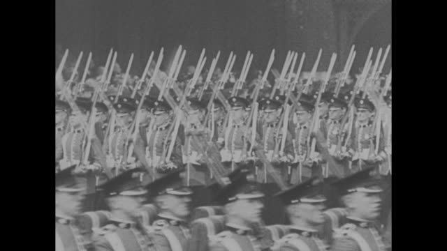 numerous shots of edward viii inspecting the 1st brigade of the irish guard / his face as he speaks to one of the guards / vs the guards march in... - saluting stock videos & royalty-free footage