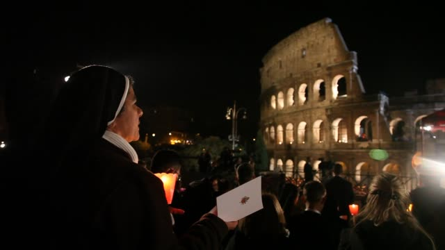A nun attends the Way of the Cross at the Colosseum held by Pope Benedict XVI on April 22 2011 in Rome Italy