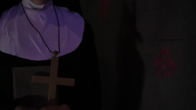 nun holding  religious cross in her hand - nun stock videos & royalty-free footage