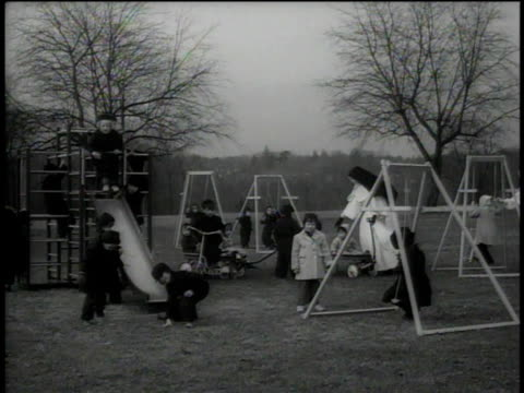1946 ws nun supervising children on a playground - katholizismus stock-videos und b-roll-filmmaterial