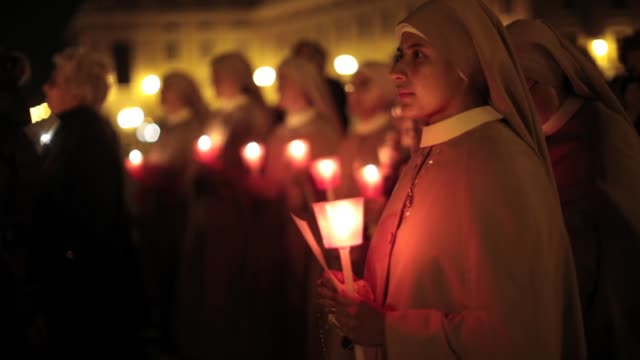 nuns and pilgrims having a candle lit vigil to give thanks to pope benedict xv1 on the eve of his retirement general views around vatican city on... - nun stock videos and b-roll footage