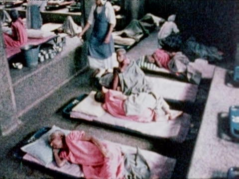 nuns care for patients lying on pallets on floor inside missionary hospital calcutta oct 79 - vita non sana video stock e b–roll