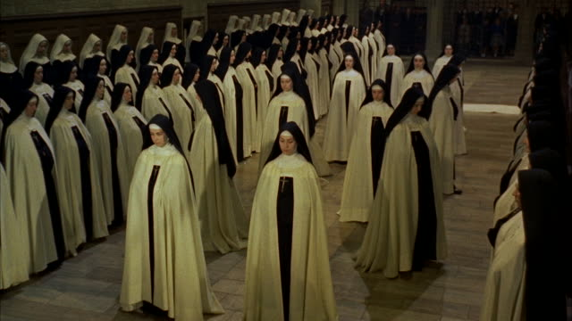 vídeos de stock, filmes e b-roll de ms nuns standing at both side of chapel           - nun