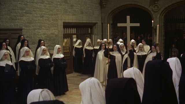 vídeos de stock, filmes e b-roll de ws nuns standing at side and novices entering in chapel - nun