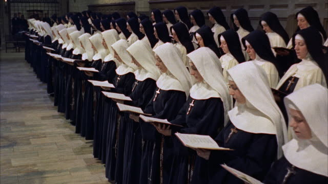 ms nuns with prayer books  - cristianesimo video stock e b–roll