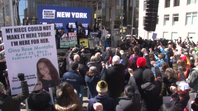 nupol kiazolu the head of the youth coalition for black lives matter greater ny addresses the crowd of protestors before the march / joined on stage... - march for our lives video stock e b–roll