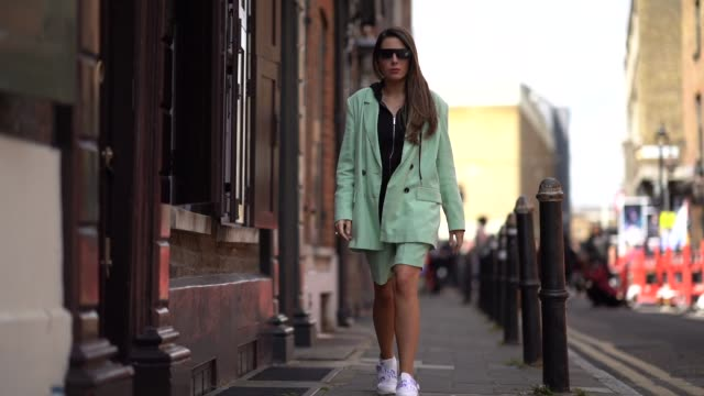 nurce erben wears sunglasses, a green blazer jacket, green shorts, a black sweater, valentino vltn sneakers, during london fashion week men's june... - trainer stock videos & royalty-free footage