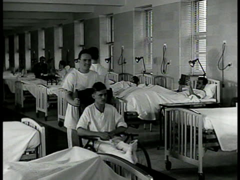 nurse amp corpsman tending to patient in bed ws patients in wardroom ms sign 'record office discharge section' ms sailors getting discharge notes ext... - hospital corpsman点の映像素材/bロール