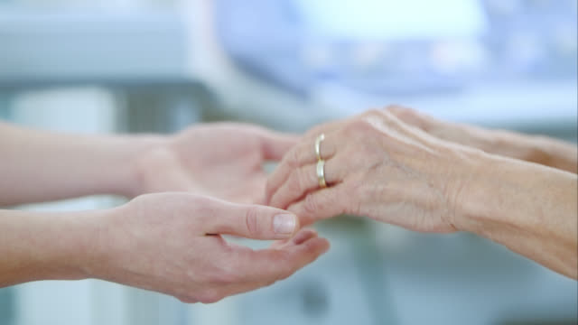 nurse and patient holding hands - trust stock videos & royalty-free footage