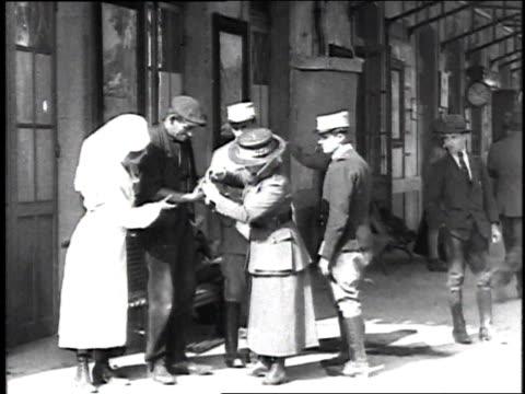 nurse and relief worker escorting injured soldier into a red cross building / france - organized group stock videos & royalty-free footage