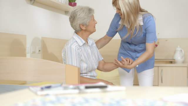 HD DOLLY: Nurse And Senior Woman Posing In Nursing Home