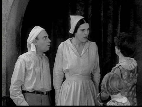 stockvideo's en b-roll-footage met 1929 b/w montage nurse announcing to anxious man that he is expecting twins/ usa/ audio - verpleegkundige
