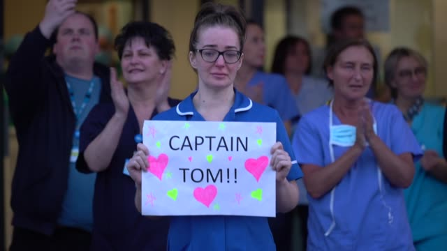 a nurse at aintree university hospital sheds a tear and as she and colleagues applaud the nhs on april 16 2020 in liverpool united kingdom following... - nhs stock-videos und b-roll-filmmaterial
