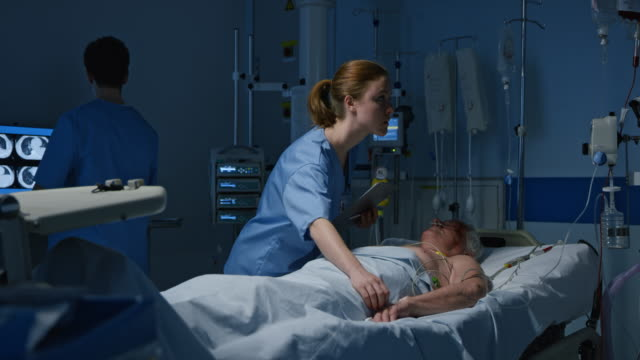 ds nurse checking a patient in the intensive care unit - lying on back stock videos & royalty-free footage