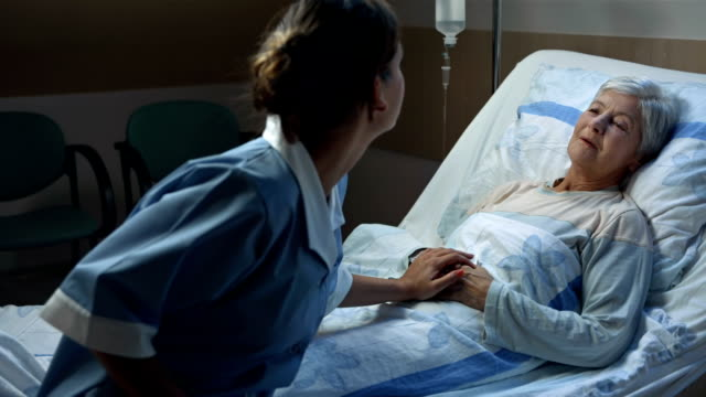hd: nurse comforting her seriously ill patient - help single word stock videos and b-roll footage