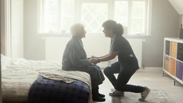 nurse doing handshake with senior woman - bathrobe stock videos & royalty-free footage