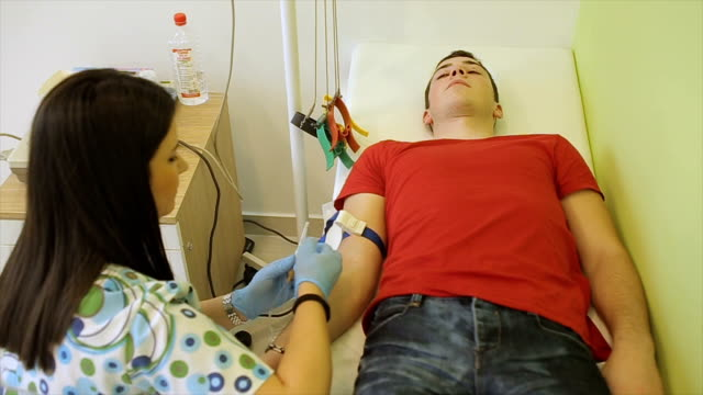 Nurse doing infusion in hospital