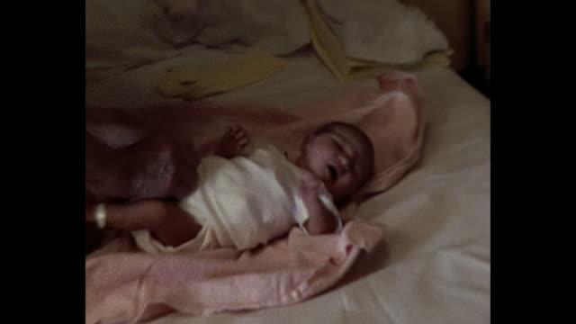 1974 nurse dressing newborn baby - female nurse stock videos & royalty-free footage