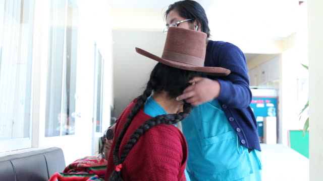 a nurse examines a peruvian woman at a medical clinic in cusco, peru. - peruvian ethnicity stock videos & royalty-free footage