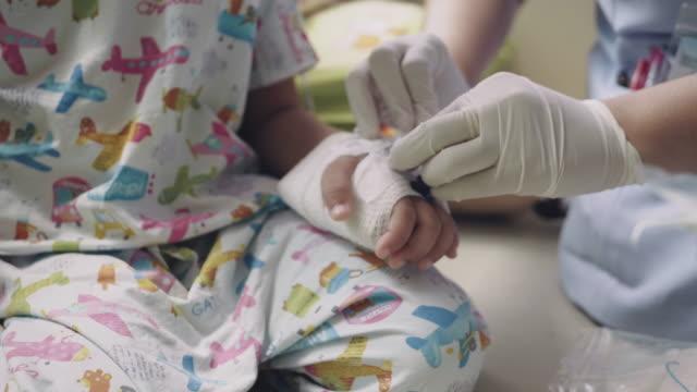 nurse examining boy in medical clinic. - plaster stock videos & royalty-free footage