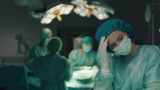 nurse feeling sad at operating room - overworked stock videos & royalty-free footage