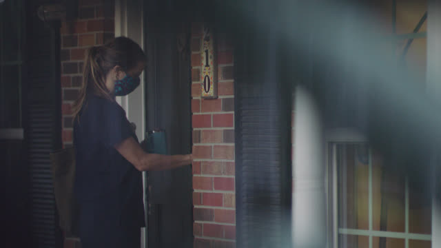 nurse gets home after working at the hospital. - arrival stock videos & royalty-free footage