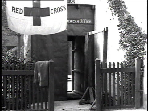 nurse greeting soldiers in front of a red cross building and escorting them indoors / france - 1918 stock videos & royalty-free footage