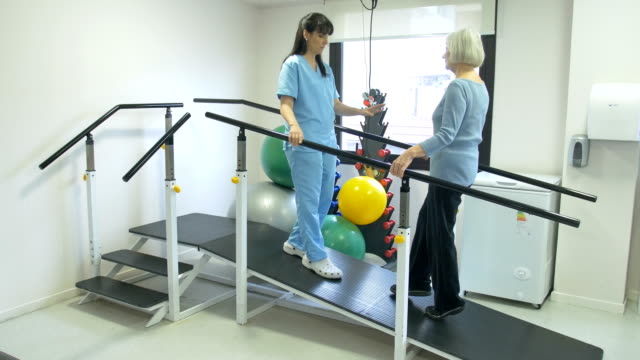 nurse guiding patient to walk on slope in rehab - rehabilitation center stock videos & royalty-free footage
