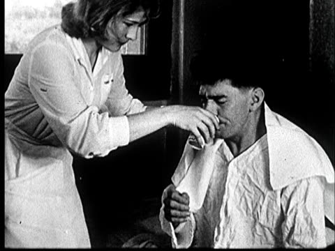 1953 ms nurse helping man drink from cup of water to take medication/ norman, oklahoma - taking medicine stock videos & royalty-free footage