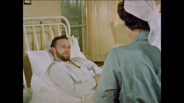 nurse helps patients in hospital - nhs stock-videos und b-roll-filmmaterial