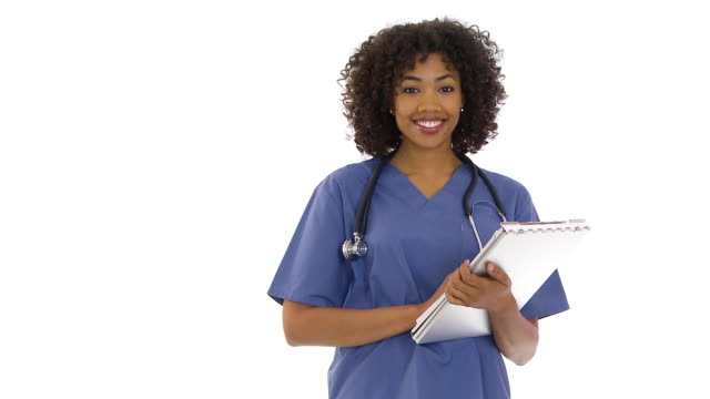 nurse holding clipboard smiling - waist up stock videos & royalty-free footage