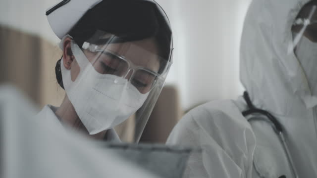 nurse in face shield - safety glasses stock videos & royalty-free footage