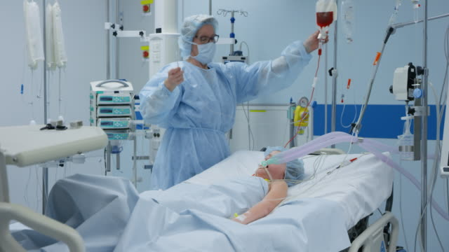 ds nurse in the intensive care giving an infusion to a young child - iv drip stock videos & royalty-free footage