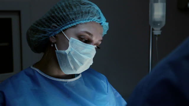nurse in the operating room. - female nurse stock videos & royalty-free footage