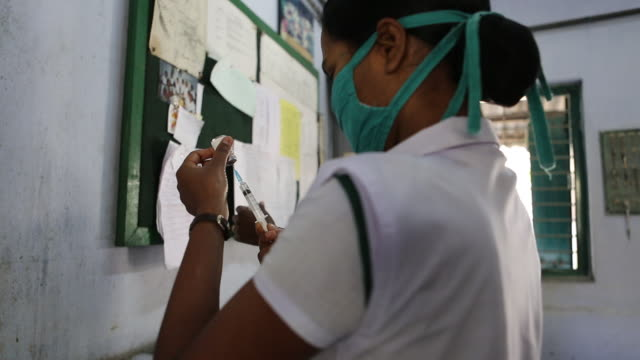 A nurse is drawing up a syringe inside of a hospital in Bagdogra It's located in the northeast of India near the city of Bagdogra Leprosy...