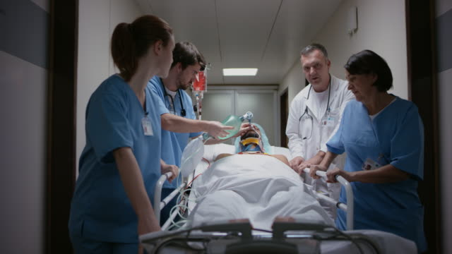 ds nurse manually ventilating a patient on the way to the or - oxygen mask stock videos & royalty-free footage